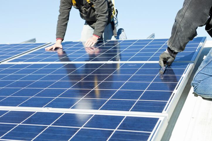 Worker's Installing Rooftop Solar Panels